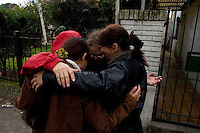 South America, Argentina, Almirante Brown, Adrogue, Evangelism - International missionaries along with locals say a prayer before they begin evangelizing on the streets of Adrogue, July 2006, ©Stephen Blake Farrington<br />