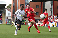 Dylan Fage of Oldham Athletic and Theo Archibald of Leyton Orient during Leyton Orient vs Oldham Athletic, Sky Bet EFL League 2 Football at The Breyer Group Stadium on 11th September 2021