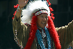 NATIVE AMERICAN IN FULL TRADIONAL GARB WAVES IN GAY PRIDE PARADE