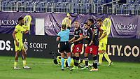 NASHVILLE, TN - SEPTEMBER 23: Referee Tori Penso shows a second yellow card, then the red card, to Russell Canouse #4 of DC United for his foul against Derrick Jones #21 of Nashville SC during a game between D.C. United and Nashville SC at Nissan Stadium on September 23, 2020 in Nashville, Tennessee.