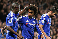 Ramires of Chelsea (left) congratulates Willian of Chelsea (2nd left) after he scored his team's second goal against Dynamo Kyiv to make it 2-1 during the UEFA Champions League Group match between Chelsea and Dynamo Kyiv at Stamford Bridge, London, England on 4 November 2015. Photo by David Horn.
