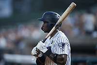 Michael Beltre (34) of the Somerset Patriots waits for his turn to bat during the game against the Altoona Curve at TD Bank Ballpark on July 24, 2021, in Somerset NJ. (Brian Westerholt/Four Seam Images)
