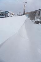 Blowing snow drifts in Kaktovik, Alaska.