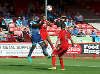 Adebayo Akinfenwa of Wycombe Wanderers challenges Jordan Roberts of Crawley Town for the ball during the Sky Bet League 2 match between Crawley Town and Wycombe Wanderers at Broadfield Stadium, Crawley, England on 6 August 2016. Photo by Alan  Stanford / PRiME Media Images.