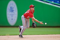 Washington Nationals first baseman Blake Chisolm (14) flips to the pitcher covering first base during a Florida Instructional League game against the Miami Marlins on September 26, 2018 at the Marlins Park in Miami, Florida.  (Mike Janes/Four Seam Images)