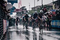 riders rolling in after finishing in the rain<br /> <br /> stage 17: Riva del Garda - Iseo (155 km)<br /> 101th Giro d'Italia 2018