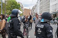 """Auf und rund um den Rosa-Luxemburg-Platz in Berlin-Mitte haben am Samstag den 25. April 2020 mehrere hundert Menschen gegen die Einschraenkungen im Zuge der Massnahmen zur Eindaeemung der Covid-19-Pandemie protestiert. Rechtsextremisten, Hooligans, Antisemiten, Verschwoerungstheoretiker und AfD-Politiker hatten zu einer sogenannten """"Hygiene-Demo"""" versammelt. Vereinzelt protestierten Menschen am Rande gegen diese Demonstration.<br /> Die Polizei war mit mehreren hundert Beamten im Einsatz und nahm mehr als 100 Personen fest.<br /> Im Bild: Ein Demonstrant haelt ein Papschild mit der Aufschrift """"Grundgesetz Art. 5 (1) Jeder hat das Recht, seine Meinung in Wort, Schrift und Bild frei zu aeussern. Eine Zensur findet nicht statt.""""<br /> 25.4.2020, Berlin<br /> Copyright: Christian-Ditsch.de<br /> [NUR FUER REDAKTIONELLE ZWECKE! Werbung nur auf Anfrage beim Fotografen. Inhaltsveraendernde Manipulation des Fotos nur nach ausdruecklicher Genehmigung des Fotografen. Vereinbarungen ueber Abtretung von Persoenlichkeitsrechten/Model Release der abgebildeten Person/Personen liegen nicht vor. NO MODEL RELEASE! Don't publish without copyright Christian-Ditsch.de, Veroeffentlichung nur mit Fotografennennung, sowie gegen Honorar, MwSt. und Beleg. Konto: I N G - D i B a, IBAN DE58500105175400192269, BIC INGDDEFFXXX, Kontakt: post@christian-ditsch.de<br /> Bei der Bearbeitung der Dateiinformationen darf die Urheberkennzeichnung in den EXIF- und  IPTC-Daten nicht entfernt werden, diese sind in digitalen Medien nach §95c UrhG rechtlich geschuetzt. Der Urhebervermerk wird gemaess §13 UrhG verlangt.]"""