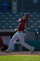 Liam Bendo (5) of the Saint Joseph's Hawks follows through on his swing against the Western Carolina Catamounts at TicketReturn.com Field at Pelicans Ballpark on February 23, 2020 in Myrtle Beach, South Carolina. The Hawks defeated the Catamounts 9-2. (Brian Westerholt/Four Seam Images)