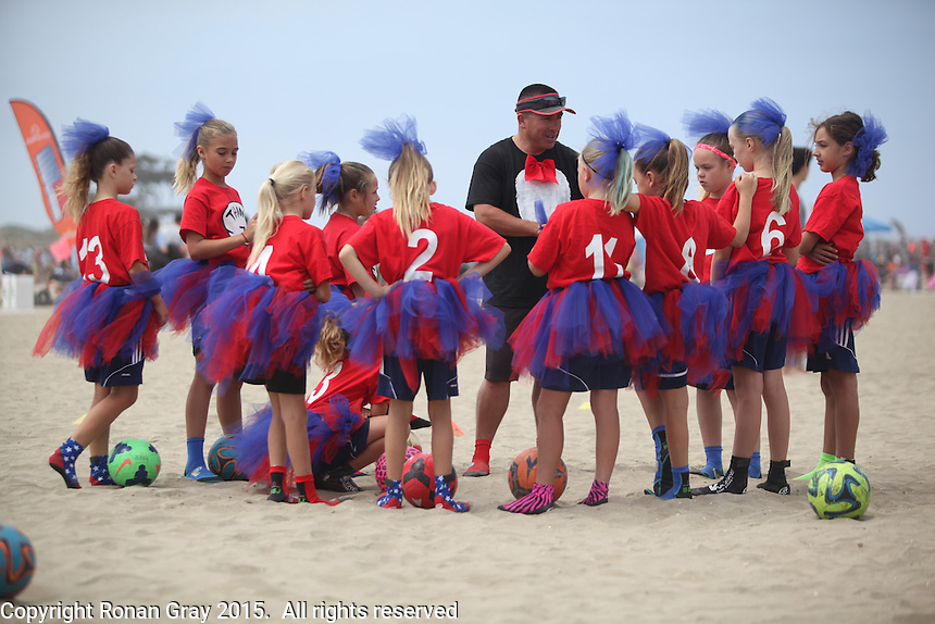 Fiesta Island, Mission Bay, San Diego CA, USA.  May 2-3, 2015:  Coach Torres of the San Diego Hotspurs speaks to his Cat-in-the-Hat themed team before their game on Sunday.  More than 150 youth and adult teams converged on Fiesta Island in San Diego for the 7th Annual Beach Soccer Jam.