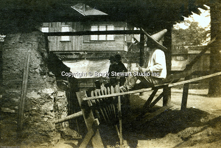 St Louis MO:  A view of a miner demonstrating how they mine for copper in the Arizona Territory.  Arizona became a state in 1912.