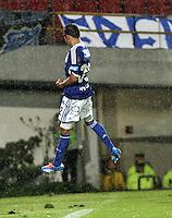BOGOTA - COLOMBIA -07 -12-2013: Jonathan Agudelo jugador de Millonarios celebra el gol anotado durante del partido por la fecha 6 de los cuadrangulares semifinales de la Liga Postobon II-2013, jugado en el estadio Nemesio Camacho El Campin de la ciudad de Bogota. / Jonathan Agudelo player of Millonarios celebrates a goal scored during a match for the 6 date of the quadrangular semifinals of the Postobon Leaguje II-2013 at the Nemesio Camacho El Campin Stadium in Bogota city, Photo: VizzorImage  / Luis Ramirez / Staff.