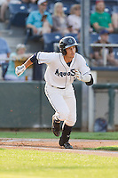 Taylor Smart #1 of the Everett AquaSox hustles to first base during a game against the Salem-Keizer Volcanoes at Everett Memorial Stadium in Everett, Washington on July 14, 2014.  Salem-Keizer defeated Everett 6-4.  (Ronnie Allen/Four Seam Images)