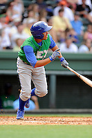 Shortstop Ramon Torres (2) of the Lexington Legends bats in a game against the Greenville Drive on Sunday, April 27, 2014, at Fluor Field at the West End in Greenville, South Carolina. Greenville won, 21-6. (Tom Priddy/Four Seam Images)