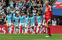 City players celebrate the 4th goal with goal scorer Raheem Sterling of Manchester City during the FA CUP FINAL match between Manchester City and Watford at Wembley Stadium, London, England on 18 May 2019. Photo by Andy Rowland.
