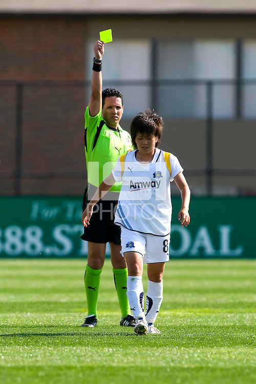 Los Angeles Sol midfielder Aya Miyama (8) receives a yellow card from referee Juan Carlos Rivero during a WPS match against the St Louis Athletica at Hermann Stadium, in St. Louis, MO, April 25 2009.  Athletica and Sol tied the match.
