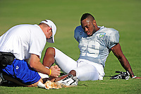 Sept. 16, 2009; Casa Grande, AZ, USA; Las Vegas Locomotives defensive back Doug Dutch is tended to by a trainer after suffering an injury during training camp at the Casa Grande Training Facility & Performance Institute. Mandatory Credit: Mark J. Rebilas-