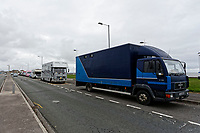 "Pictured: Dozens of horse boxes parked outside Aberavon Beach Hotel in Port Talbot, Wales, UK. Monday 08 October 218<br /> Re: A grieving father will mourners on horseback at the funeral of his ""wonderful"" son who killed himself after being bullied at school.<br /> Talented young horse rider Bradley John, 14, was found hanged in the school toilets by his younger sister Danielle.<br /> Their father, farmer Byron John, 53, asked the local riding community to wear their smart hunting gear at Bradley's funeral.<br /> Police are investigating Bradley's death at the 500-pupils St John Lloyd Roman Catholic school in Llanelli, South Wales.<br /> Bradley's family claim he had been bullied for two years after being diagnosed with Attention Deficit Hyperactivity Disorder.<br /> He went missing during lessons and was found in the toilet cubicle by his sister Danielle, 12."