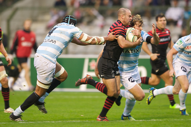 20121020 Copyright onEdition 2012©.Free for editorial use image, please credit: onEdition..Charlie Hodgson of Saracens breaks past Karim Ghezal (left) and Mirco Bergamasco of Racing Metro 92 during the Heineken Cup Round 2 match between Saracens and Racing Metro 92 at the King Baudouin Stadium, Brussels on Saturday 20th October 2012 (Photo by Rob Munro)..For press contacts contact: Sam Feasey at brandRapport on M: +44 (0)7717 757114 E: SFeasey@brand-rapport.com..If you require a higher resolution image or you have any other onEdition photographic enquiries, please contact onEdition on 0845 900 2 900 or email info@onEdition.com.This image is copyright the onEdition 2012©..This image has been supplied by onEdition and must be credited onEdition. The author is asserting his full Moral rights in relation to the publication of this image. Rights for onward transmission of any image or file is not granted or implied. Changing or deleting Copyright information is illegal as specified in the Copyright, Design and Patents Act 1988. If you are in any way unsure of your right to publish this image please contact onEdition on 0845 900 2 900 or email info@onEdition.com