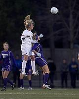 "Boston College midfielder Kate McCarthy (21) and University of Washington forward McKenna Waitley (14) battle for head ball. In overtime, Boston College defeated University of Washington, 1-0, in NCAA tournament ""Elite 8"" match at Newton Soccer Field, Newton, MA, on November 27, 2010."