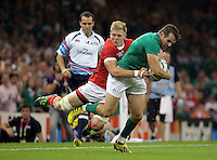 Pictured: Jared Payne of Ireland (R) brought down by Ray Barkwill of Canada (L) Saturday 19 September 2015<br /> Re: Rugby World Cup 2015, Ireland v Canada at the Millennium, Stadium, Wales, UK