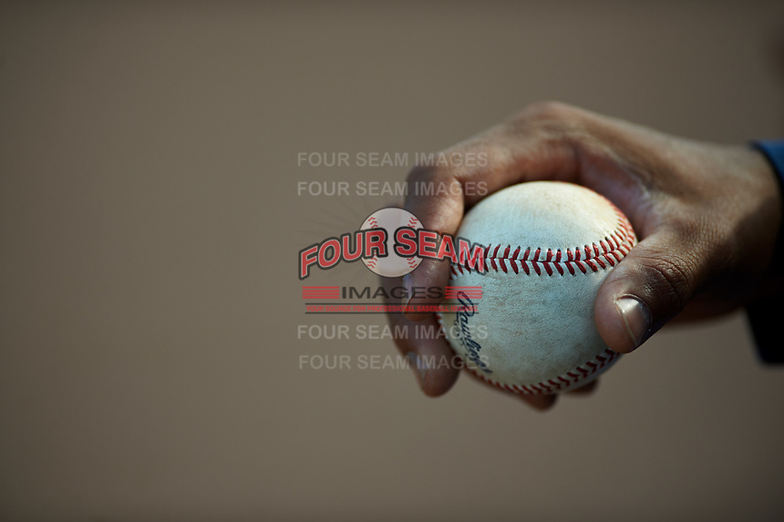 A Lake Elsinore Storm player holds a baseball during a California League game against the Inland Empire 66ers on April 14, 2019 at The Diamond in Lake Elsinore, California. Lake Elsinore defeated Inland Empire 5-3. (Zachary Lucy/Four Seam Images)