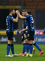 Calcio, Serie A: Inter Milano - Atalanta, Giuseppe Meazza (San Siro) stadium, in Milan, March 8, 2021.  <br /> Inter's Milan Skriniar (R)  elebrates with his teammate Stefan De Vrij (L) after winning 1-0 the Italian Serie A football match between Inter and Atalanta at Giuseppe Meazza (San Siro) stadium, on  March 8, 2021.  <br /> UPDATE IMAGES PRESS/Isabella Bonotto