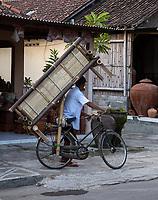 Yogyakarta, Java, Indonesia.  Transporting Furniture on a Bicycle.