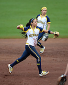 Michigan Wolverines during the shortstop Sierra Romero (32) throws to first on the run as second baseman Abby Ramirez (1) backs up the play during the teams season opener against the Florida Gators on February 8, 2014 at the USF Softball Stadium in Tampa, Florida.  Florida defeated Michigan 9-4 in extra innings.  (Mike Janes/Four Seam Images via AP Images)