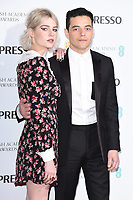 Lucy Boynton and Rami Malek<br /> arriving for the 2019 BAFTA Film Awards Nominees Party at Kensington Palace, London<br /> <br /> ©Ash Knotek  D3477  09/02/2019