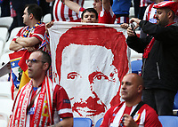 16th May 2018, Stade de Lyon, Lyon, France; Europa League football final, Marseille versus Atletico Madrid; Atletico Madrid fan holds up banner of Atletico Madrid manager Diego Simeone face