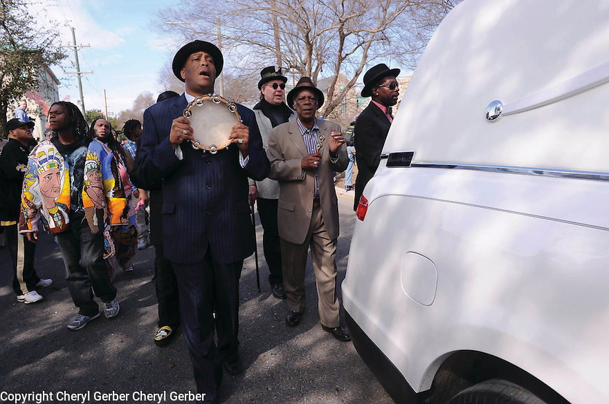 Big Chief Monk Boudreaux and other Mardi Gras Indians follow the hearse of Big Chief Bo Dollis, 2015
