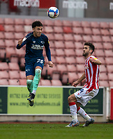 20th March 2021; Bet365 Stadium, Stoke, Staffordshire, England; English Football League Championship Football, Stoke City versus Derby County; Lee Buchanan of Derby County heads the ball in front of Tommy Smith of Stoke City