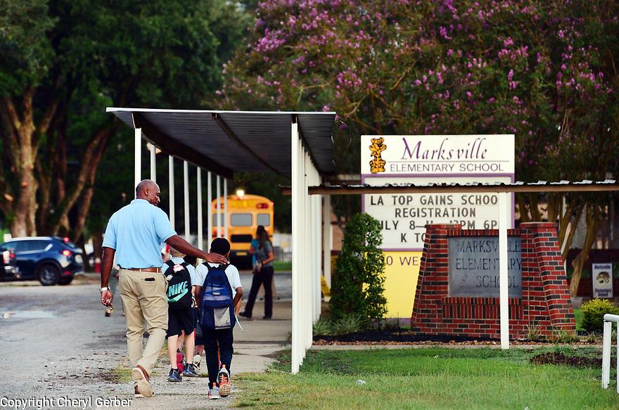 Alex Perkins walks students to Marksville Elementary School in Marksville, La., Sept. 18, 2017.