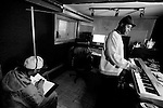 BROOKLYN -- FEBRUARY 10, 2009:  Rapper Brooklyn Chase (L) works on some lyrics before recording a track in Keff Moore's (R) Flatbush recording studio on February 10, 2009 in Brooklyn.  (PHOTOGRAPH BY MICHAEL NAGLE).
