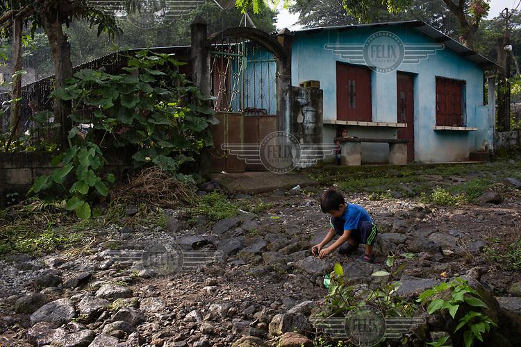 Children play in the rain in the community of 15 de Octubre La Trinidad.