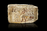 Ancient Egyptian stele showing Iti & Neferu receiving food offerings, First Intermediate Period, (2118-1980 BC), Gebelein, Tomb of Iti & Neferu,  Egyptian Museum, Turin. black background.  Schiaparelli cat 13114.