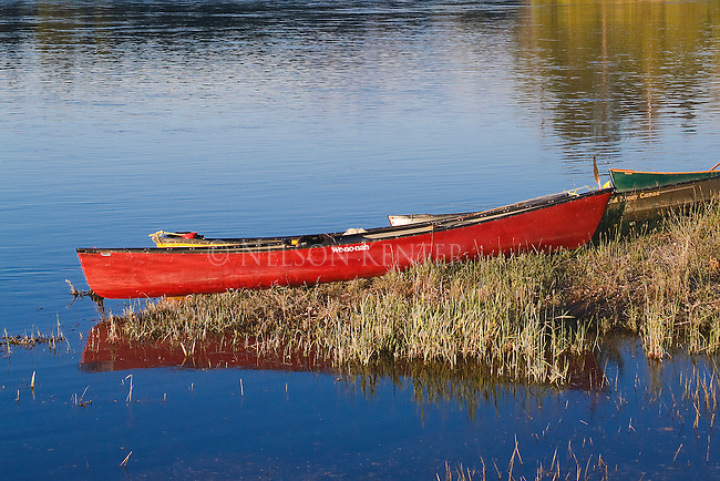 Canoes on the shore of the Flathead River in western Montana above Dixon