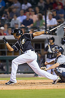 Marcus Semien (6) of the Charlotte Knights follows through on his swing against the Pawtucket Red Sox at BB&T Ballpark on August 9, 2014 in Charlotte, North Carolina.  The Red Sox defeated the Knights  5-2.  (Brian Westerholt/Four Seam Images)