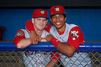 Williamsport Crosscutters Dylan Bosheers (17) and Jan Hernandez (12) in the dugout before a game against the Batavia Muckdogs on August 27, 2015 at Dwyer Stadium in Batavia, New York.  Batavia defeated Williamsport 3-2.  (Mike Janes/Four Seam Images)