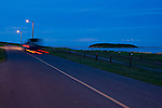 A truck puling a boat drives along a road after a long day on the water in Fort Chipewyan