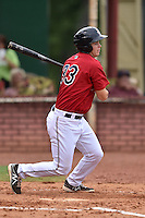 Elizabethton Twins first baseman Trey Vavra #33 swings at a pitch during a game against the  Bristol Pirates at Joe O'Brien Field June 30, 2014 in Elizabethton, Tennessee. The Twins defeated the Pirates 8-5 in game one of a double header. (Tony Farlow/Four Seam Images)