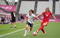 KASHIMA, JAPAN - AUGUST 2: Kelley O'Hara #5 of the United States battles for the ball with Janine Beckie #16 of Canada during a game between Canada and USWNT at Kashima Soccer Stadium on August 2, 2021 in Kashima, Japan.