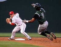 Second baseman Sean Coyle (5) of the Greenville Drive, Class A affiliate of the Boston Red Sox, gets the putout at second on Chris Lofton (5) of the Augusta GreenJackets on April 7, 2011, at Fluor Field at the West End in Greenville, S.C. Photo by Tom Priddy / Four Seam Images