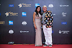 John Daly and his partner walks the Red Carpet event at the World Celebrity Pro-Am 2016 Mission Hills China Golf Tournament on 20 October 2016, in Haikou, China. Photo by Marcio Machado / Power Sport Images