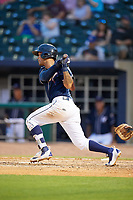 Northwest Arkansas Naturals shortstop Humberto Arteaga (6) follows through on a swing during a game against the Midland RockHounds on May 27, 2017 at Arvest Ballpark in Springdale, Arkansas.  NW Arkansas defeated Midland 3-2.  (Mike Janes/Four Seam Images)