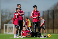 SWANSEA, WALES - FEBRUARY 17: ( L-R )  Leon Britton, Gylfi Sigurosson  Jonjo Shelvey  and Ki Sung-Yueng of Swansea City  watch team mates  during training session at the Fairwood training ground on February 17, 2015 in Swansea, Wales.  (Photo by Athena Pictures )