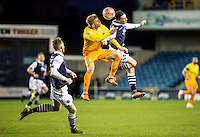Jason McCarthy of Wycombe Wanderers and Shaun Williams of Millwall go up for the ball during the FA Cup 2nd round match between Millwall and Wycombe Wanderers at The Den, London, England on 5 December 2015. Photo by Daniel Dudgeon  / PRiME