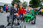 On their little tractor and pedal car at the vintage tractor run in Abbeydorney on Sunday, l to r: Ava and Kyle Hussey and Tom O'Connor with Michael Healy Rae TD.