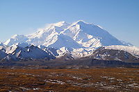 Winds whip Mt. McKinley on a sunny fall day.