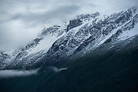 A June storm brings snow down to the 1,000 foot elevation in the Chugach Mountains of Alaska.